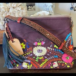 Consuela crossbody with nicer strap and tassel